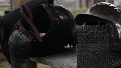 Steel armour and helmet with chain mail facemask prepared by warrior for Crusade Stock Footage
