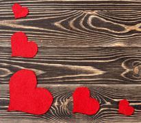 Handmade hearts against wood-grain wall Stock Photos