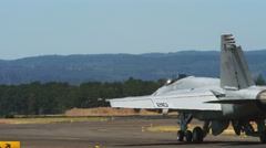 F-18 jet taxiing down runway Stock Footage