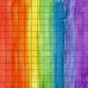 Rainbow watercolor background on math paper - stock photo