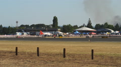 Stunt jet taxiing through frame at an air show Stock Footage