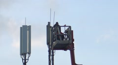 Workers On Hydraulic Ramp Repair Antenna Stock Footage