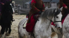 Men wearing ancient suits riding horses, medieval town atmosphere at museum Stock Footage
