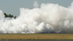 Thick smoke from jet cars on tarmac at Hillsboro Air Show Stock Footage