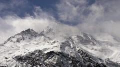 Stormy Clouds Roll Over Snow Capped Mountains and Glaciers. - stock footage