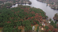 Over rural residential area and lake south of Boston. Shot in November 2011. Stock Footage