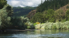 Heading toward rapids in the canyon of the Rogue River, Oregon - stock footage