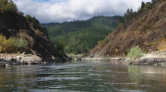Drifting through a narrow section of the Rogue River Canyon, Oregon Stock Footage