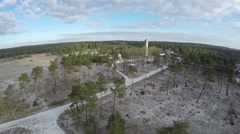 Aerial UAV bird view of snowy heath landscape towards concrete water tower 4k Stock Footage