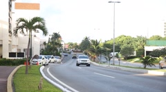 Caribbean street road with cash collector car Stock Footage