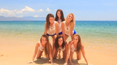Closeup cheerleaders show simple pyramid on all fours wave hands Stock Footage