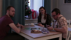 A group of people playing a board game and a card Stock Footage