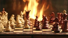 Chess game by fireplace - stock footage