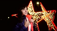 Woman girl night jacket scarf and dark winter star light  bokeh Stock Footage