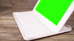A man types on a laptop on his desk. Green screen for your custom screen content Stock Footage
