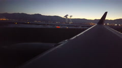 POV-Airline taxiing out at first light of winter day steam in background Stock Footage