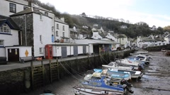 Polperro Cornwall UK out of season in winter quiet smooth pan Stock Footage