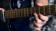 The guy playing the guitar solo - stock footage