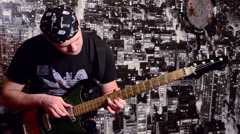 Stock Video Footage of Brutal rocker learning to play bass guitar