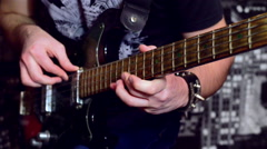 Metalist plays the guitar solo. Closeup - stock footage