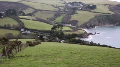 Talland Bay coast Cornwall between Looe and Polperro England UK pan of coastline Stock Footage