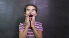 girl experiencing teen surprising happiness joy gray background - stock footage