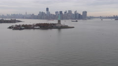 Flying past Liberty Island toward Manhattan skyline in background. Shot in 2011. - stock footage