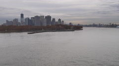 Flying past Governor's Island up the East River with Manhattan in background. Stock Footage