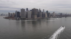 Small ferryboats in East River with Manhattan skyline in background. Shot in Stock Footage