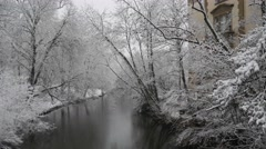 4k Winter fresh snow river Oker city forest Braunschweig panning Stock Footage