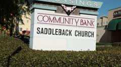 Passing the sign for the Saddleback Church in Orange County, California Stock Footage
