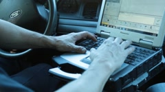 Police Officer's Hands on Patrol Car Laptop - stock footage