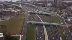 Over Interstate 95 in Providence, Rhode Island, heading toward industrial area Stock Footage