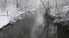 4k Winter fresh snow river Oker city forest Braunschweig tilt Stock Footage