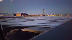 POV-Airline takeoff in early morning airport lights from snowy Salt Lake City Stock Footage
