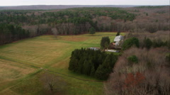Over rural residence in woods west of Providence, Rhode Island. Shot in November Stock Footage