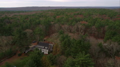 Over rural home in woods near Scituate Reservoir, west of Providence, Rhode Stock Footage