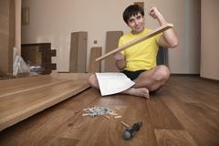 Young man assembling furniture Stock Photos