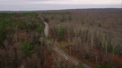 Following a highway through a forest west of Providence, Rhode Island. Shot in Stock Footage