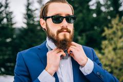Groom in a blue suit in the mountains Carpathians Stock Photos