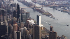 Flying up the East River toward UN Building and Roosevelt Island, spanned by Stock Footage