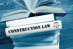 Book with Construction Law word on table in a courtroom or enforcement office Stock Photos