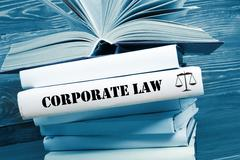 Book with Corporate Law word on table in a courtroom or enforcement office Stock Photos