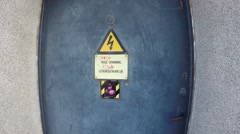 Danger high voltage sign moving towards from ISO warning symbol 4k Stock Footage