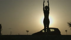Stock Video Footage of Female silhouette doing yoga exercises for harmony of healthy body and mind