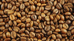 Roasted coffee beans with smoke Stock Footage