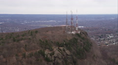Past telecommunication towers on a rugged hill north of New Haven, Connecticut. - stock footage