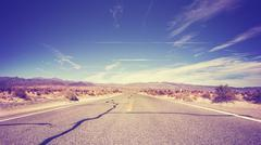 Vintage stylized endless country highway, USA. - stock photo