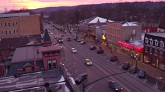 Aerial shot of Main Street USA during Christmas season at sunset Stock Footage