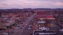 Aerial shot of main street midwest during Christmas season at sunset  Stock Footage